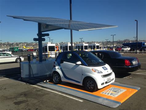 electric cars charging self contained solar carport with battery electric car
