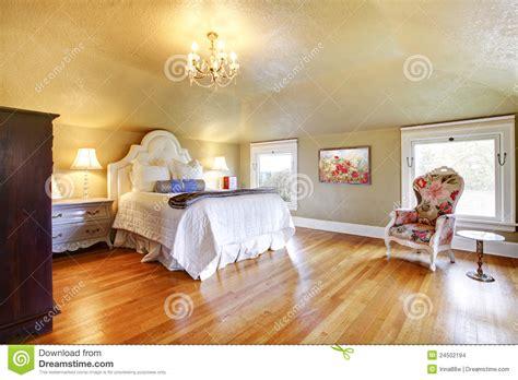 gold luxury bedroom  white bedding stock photo