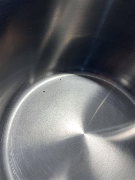 stainless steel cookware pitting cooking