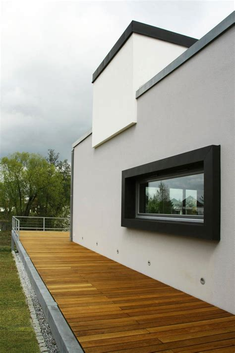 white wall exterior decorating  wooden flooring  terrace  fence  window  black