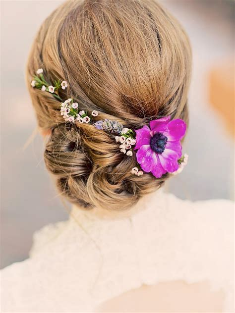 Flower Updo Hairstyles by 17 Wedding Hairstyles For Hair With Flowers