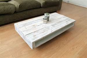 39on Wheels39 Wood Coffee Table With A Whitewash Finish By