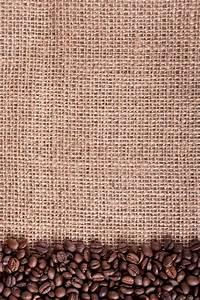 Coffee beans frame macro on canvas background - burlap ...