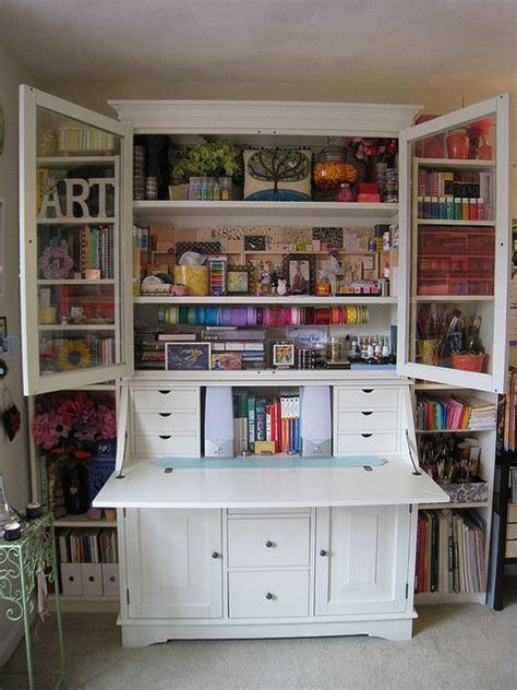 25 best ideas about craft cabinet on craft armoire scrapbook storage and craft