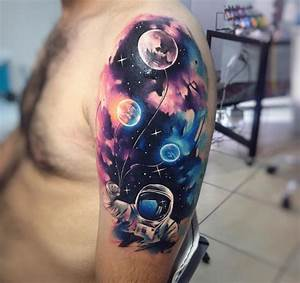 Astronaut Holding Planet Balloons | Best tattoo design ideas