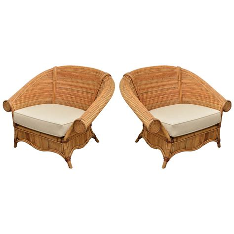 large pair of rattan chairs with upholstered linen