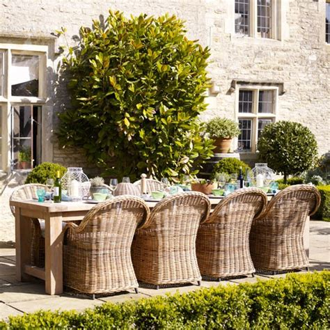 modern country style using grey rattan kubu chairs in