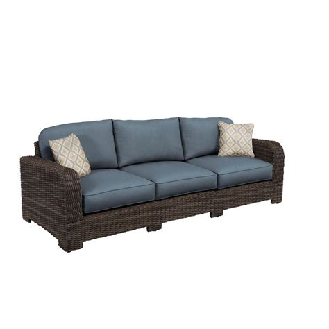 brown northshore patio sofa with denim cushions and