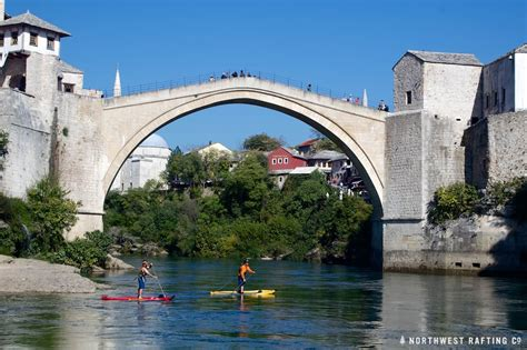 Paddleboarding through the Stari Most in Bosnia ...