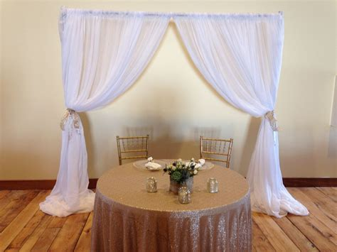 Beautiful Wedding Backdrop With White Sheer Drapes Behind