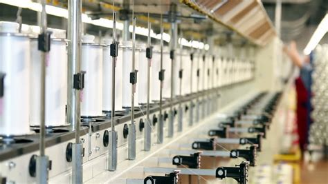 engineer controlling manufacturing process  textile