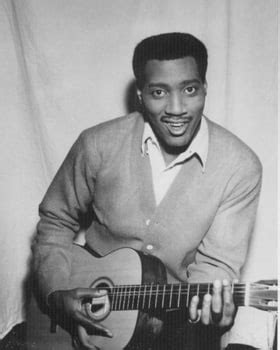 Otis Redding. Only picture I've ever seen with him holding ...
