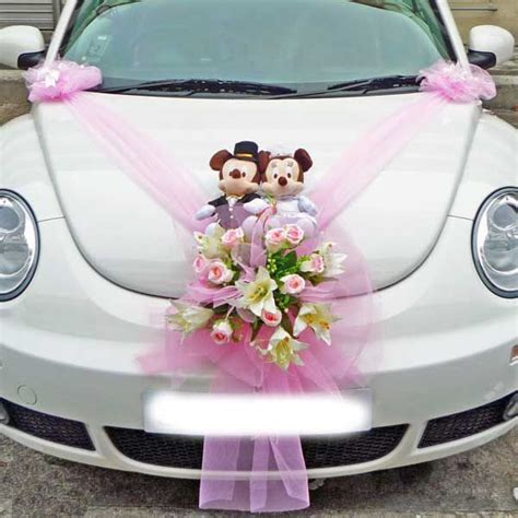 wedding car decoration tulle with floral bouquet topped by mickey and minnie a fairytale