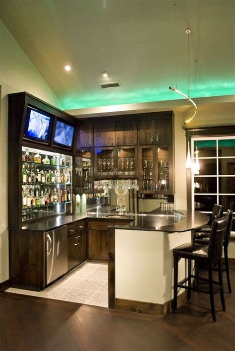 bar ideas for the home for the den upstairs by the fireplace bar equipped with two tv s and bar stools how