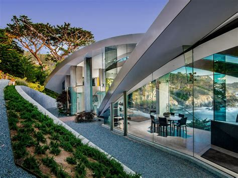 This Butterfly Shaped Concrete, Glass & Steel House is a