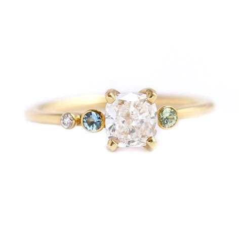 asymmetric diamond cluster engagement ring with aquamarine and mint ga artemer