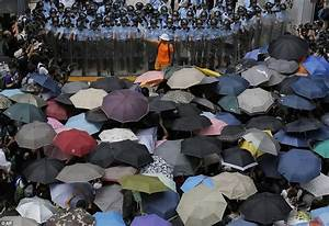 Hong Kong protests cleared by riot police using pepper ...