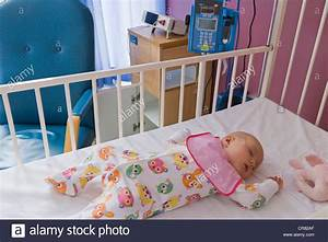 Baby girl, 6 months, sleeping in the cot bed in the NHS ...
