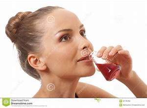 Woman Drinking A Red Liquid Stock Photography