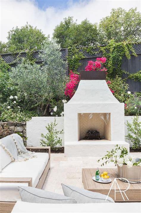 Alyssa Rosenheck White Stucco Patio Fireplace