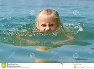 Little Girl Swimming In Lake Stock Photo - Image: 27177340