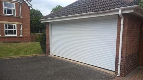 single garage door conversion from two single doors to one garage door