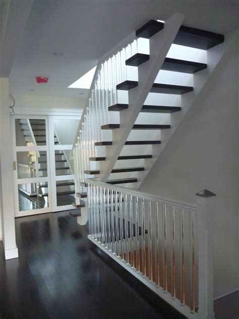 spindles for stairs Staircase Contemporary with carpeted
