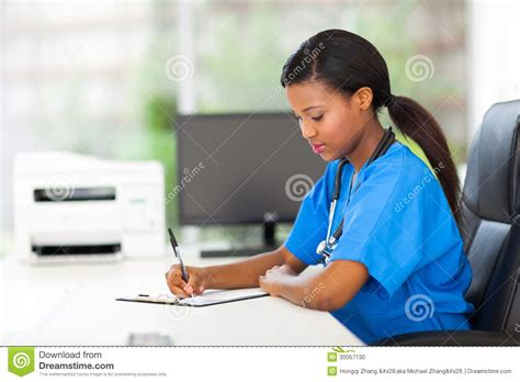Pediatric Assistant by Writing Reports Stock Photo Image 30057130
