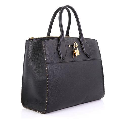 louis vuitton city steamer handbag studded leather mm  sale  stdibs