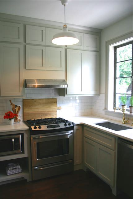 revere pewter cabinets. White subway tile with putty color
