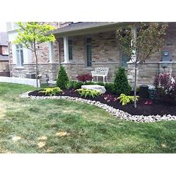 Red Brick House With Front Yard Landscaping Gardening Flower And
