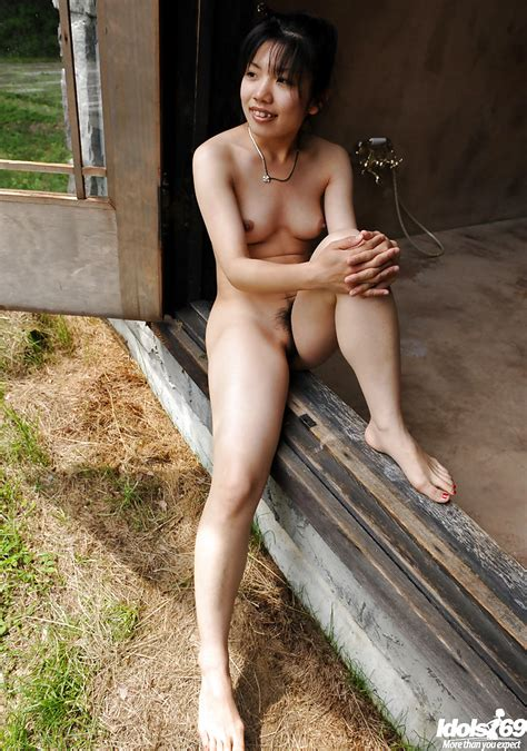 sweet asian babe with hairy pussy and tiny tits posing naked outdoor