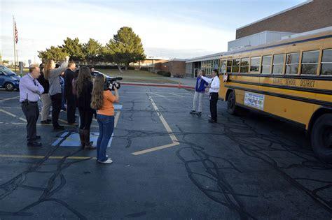 student designed ads adorn granite school district buses