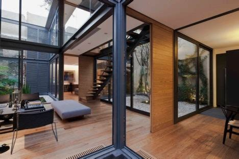 gleaming glass  house   green courtyards