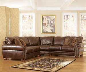 Durablend antique stationary sofa sectional by signature for Brown leather sectional sofa ashley furniture