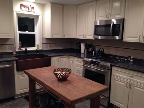 copper sink with stainless steel appliances blue pearl granite antique white cabinets and copper