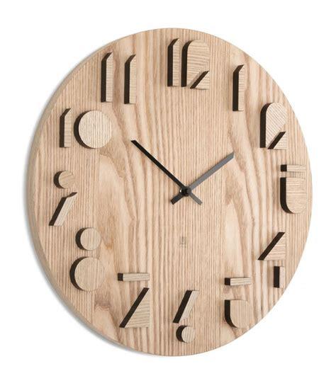 poubelles cuisine originales horloge design murale en bois shadows umbra