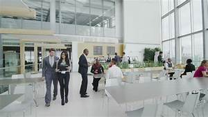 Business People Take A Break In Large Office Cafe Area ...