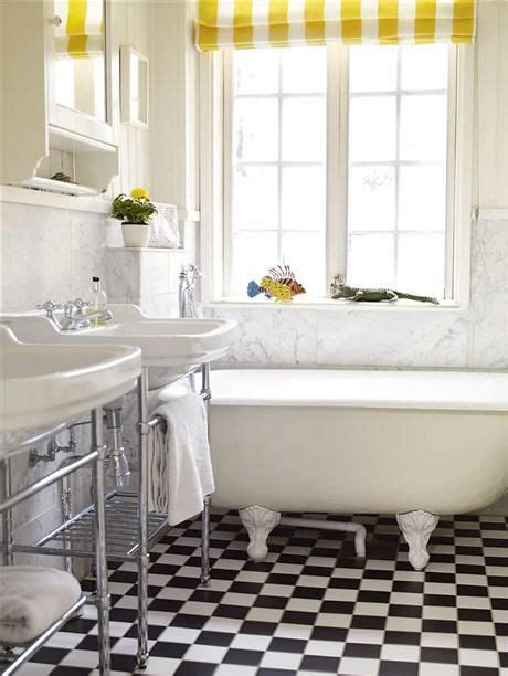 black white and yellow bathroom yellow white striped roman shade black white checkerboard floor great dual sinks marble