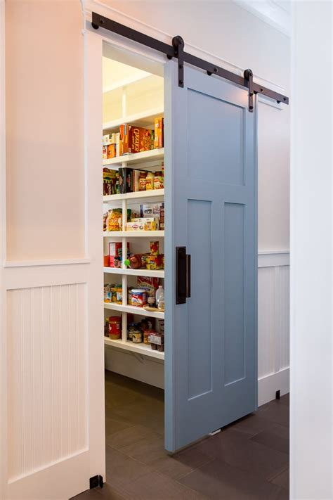 Wood Food Pantry by Sliding Doors To Butlers Pantry Kitchen Beach Style With