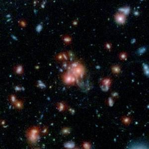 NASA Telescopes Find Galaxy Cluster with Vibrant Heart | NASA