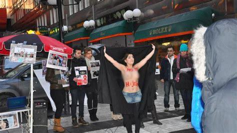 iranian women organize topless protest  hijabs