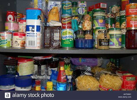 Cupboard Food by Shelves In A Food Cupboard Of Groceries Stock Photo