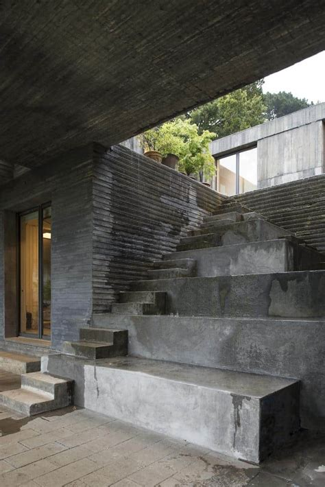 fascinating square concrete house sits   small