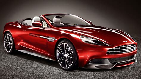 aston martin vanquish red aston martin s top less luxury vanquish volante unveiled