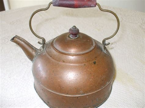 antique copper tea kettle  red wood handle