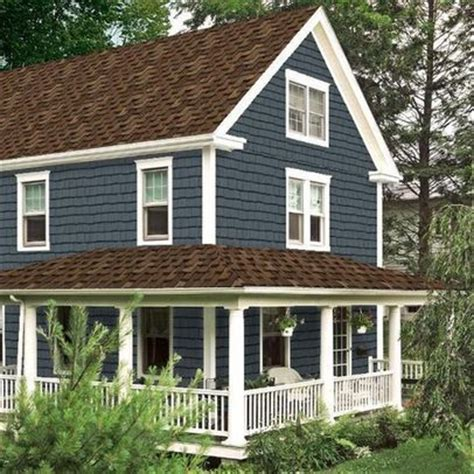 wanting this color of house with our new brown roof hoping the color of the roof is what i was