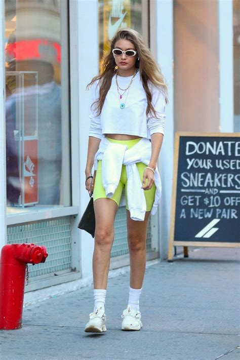 Gigi Hadid looks trendy in a white crop top and green ...