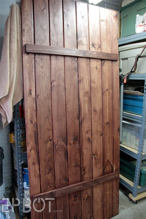 how do you make a door into a swinging bookcase epbot make your own sliding barn door for cheap