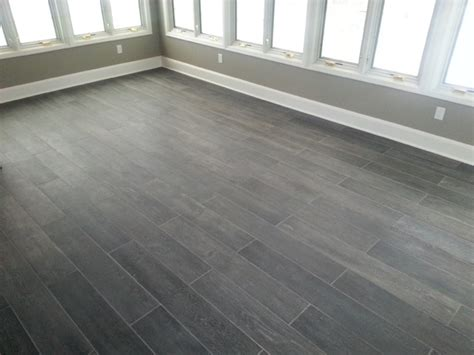 gray plank tile sunroom plank tile floor traditional sunroom new york by groundswell contracting